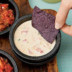 Spicy Queso. Ingredients: 1 small onion, diced 1 tablespoon oil 1 garlic clove, minced 1 (16-oz.) package pepper Jack pasteurized prepared cheese product, cubed 1 (10-oz.) can diced tomatoes and green chiles 2 tablespoons chopped fresh cilantro Tortilla chips