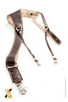 XbeltPro straps for photographers. Allows to carry 1, 2 or 3 cameras keeping your back healthy www.xbeltpro.com