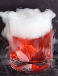 A deliciously spooky way to toast Halloween, our Bubbling and Bloody Witch& Brew cocktail is made with club soda, rum, grenadine and an ice-cube-sized chunk of dry ice. Dry Ice Halloween, Halloween Bebes, Adult Halloween Party, Holidays Halloween, Halloween Treats, Halloween Decorations, Halloween Foods, Halloween Desserts, Happy Halloween