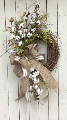 Love this wreath made with cotton branchs, listing at https://www.etsy.com/listing/245783460/cotton-wreath-cotton-boll-wreath