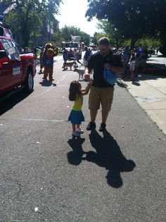 Passing out candy of the Coast Guard Festival Kid's Parade in Grand Haven on July 28, 2012