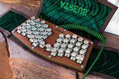 Our key caps and custom keyboard case on an Atreus Ergonomic keyboard. Find the keyboard at Atreus.technomancy.us #atreus #typewriter #ergo #green #embroidery #customgreencase