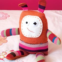 Adorable monster. make it from knitted and fabric rectangles.