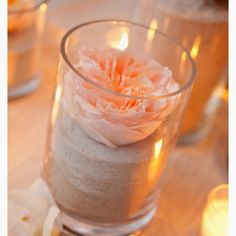 Easy beach centerpiece, sand, flower and candles. For more ideas visit www.DIYBudgetWeddings.com
