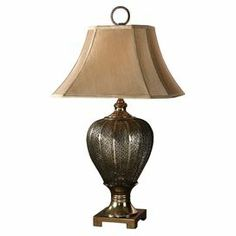 """Table lamp with an urn-inspired base and antiqued silver and champagne finish.   Product: Table lampConstruction Material: Metal and fabricColor: Antique silver and champagneAccommodates: (1) 150 Watt bulb - not includedDimensions: 33"""" H x 18"""" W x 18"""" D"""