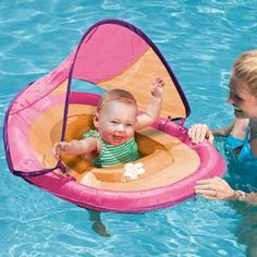 Swim Ways Brand- Baby Spring Float W/Sun Canopy. is a great holiday gift for parents with a new baby. This Is A Great Float For Baby because it sits them down lower, keeping their center of Gravity low and there by reducing the chances of the float being tipped over and/or baby falling out. All while Giving baby a greater feeling of independence as they kick and play. Plus the sun canopy does offer some protection from sun burn. Comes in a variety of styles and colors.