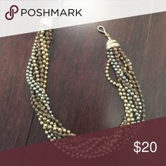 Twisted Necklace/Bracelet Can be worn as both a necklace or a bracelet (when looped twice) -- measures a little over 18 inches Jewelry