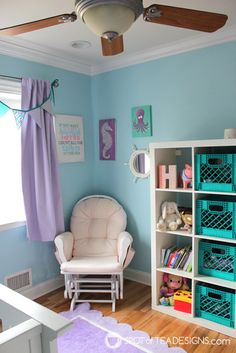 See an inspiring under the sea themed baby nursery made for a little girl with light blues, pinks and purples! Includes DIY projects made by mom!