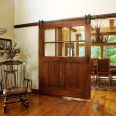 Big sliding barn door with glass windows.