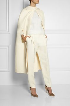 Total white look with Valentino cape
