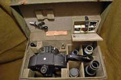 U.S. Army Signal Corps, Bell & Howell 35mm Eyemo 71-Q (PH-330-G) motion picture camera used during World War II. (placed in its original case with accessories.)