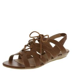 """Get a lightweight look and feel in this sandal from American Eagle. It features a tumbled upper, laces for good fit, stretchy slingback, padded footbed, 1"""" mini wedge, and a ribbed outsole. Manmade materials."""