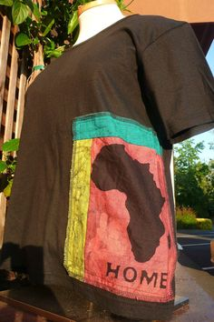 Africa HOME Batik Organic Tshirt with FREE STICKER by IOGoods, $25.00  https://www.etsy.com/listing/100584249/africa-home-batik-organic-t-shirt-with