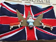 Yarn bombers create a Union flag with corgis and the Queen. Northallerton's Ninja Knitters & Samurai Stitchers of North Yorkshire UK