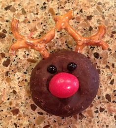 Reindeer Donuts with red M and pretzles - perfect dessert for a holiday / christmas party