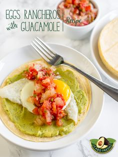 Gather the family for #brunch this weekend and surprise them with Eggs Rancheros with Guacamole.  A chunky Ranchero sauce made with juicy plum tomatoes, onion, jalapeño and garlic is spooned over fried eggs and served on warm corn tortillas layered with your choice of Cabo Fresh Guacamole. Now that makes any morning memorable. You'll find the complete recipe on our website.   http://cabofresh.com/recipes/breakfast-brunch/eggs-rancheros-with-guacamole/