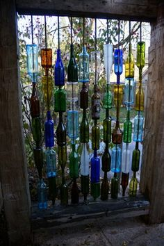 Coolest backyard ever eclectic-landscape-   bottle fence