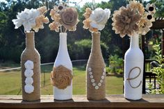 Upcycled jute / twine / yarn wrapped wine bottles featuring handmade roses spelling out 'Love' on Etsy, $30.00