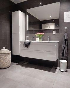 A modern Scandinavian bathroom with dark tiles .- A modern Scandinavian bathroom with dark tiles and white bathroom furniture. – – Source by - Bathroom Vanities For Sale, White Bathroom Furniture, Bathroom Mirror Cabinet, Grey Bathrooms, Bathroom Ideas, Simple Bathroom, Modern Bathroom, Master Bathroom, House 2