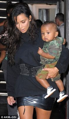 He is the newest addition to the family. But on Monday nine-month-old Saint certainly stole the limelight as he stepped out with his father Kanye West, mother Kim Kardashian, and older sister North.