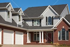 Lovely Home, Red Brick and Vinyl Siding, Attached Garage, Dormers Royalty Free Stock Photo