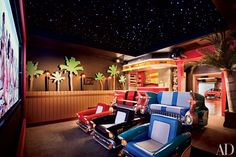 16 Home Theater Design Ideas for the Most Luxurious Movie Nights The theater of this Connecticut home—designed by Theo Kalomirakis, complete with a snack bar—is reminiscent of a drive-in. Using real cars proved impossible, but Kalomirakis and his tea Home Theater Furniture, Home Theater Decor, Best Home Theater, Home Theater Seating, Home Theater Design, Theater Seats, Boat Furniture, Movie Theater Rooms, Drive In Theater