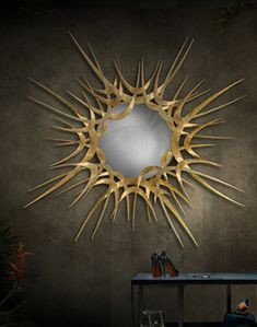 GUILT sunburst mirror by Koket.