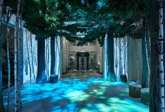 An immersive Christmas tree installation by Apple's Jonathan Ive and industrial designer Marc Newson has been unveiled at Claridge's hotel in London.