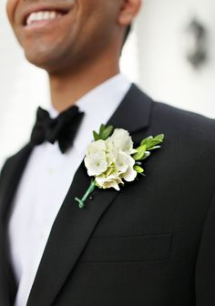 boutonniere : simple white. (What if the hydrangea were the periwinkle color??). Love this!!!  (I think the flower behind is a white rose)