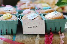 frilly ribbon whimsical first birthday party pink blue yellow glazed donuts