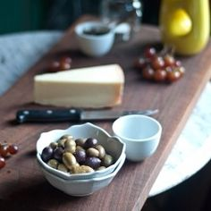 Parrano Cheese Plate with Balsamic Onion Marmalade, Green Olives, and Red Grapes