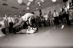 Things get crazy on the dance floor and one groomsman looks a little afraid of being crushed by the groom! Thanks to Love Shutter Photographer in North Carolina for this one.