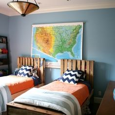Shared boys' room with creative storage, homemade pallet beds, and an emphasis on these brothers' love for geography.