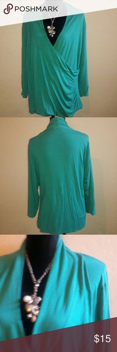 Coldwater Creek Top Turquoise top with a slight gathering in front to extinguish the bulge and show the curves of the waist line. Also it is a low cut in chest area but can be worn with a spagheti strap top underneath... 24' armpit to armpit and the sleeves are 19' down which is like a 3/4 sleeve... Coldwater Creek Tops Tunics