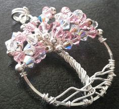 Handmade Sterling Silver Wire Wrapped Pink Hope Tree of Life Pendant by goosecrossingfarm. Made with 33 pink and clear Aurora Borealis Swarovski crystals, 17 smooth 3mm sterling silver beads and more than five feet of sterling silver wire. $68.00