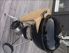 DIY folding table for Weber grill, folded. Couldn't decide on grill board or woodworking board.