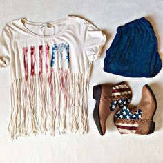 American Flag Fringe Crop Top The absolute perfect top for the Fourth of July! It looks so cute with a pair of high-waisted shorts and some cowgirl boots. Tag says size large but because of the open fringe it could fit sizes M-XL Havana Tops Crop Tops