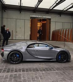 Bugatti Chiron painted in Gray w/ Blue accents and exposed carbon fiber    Photo taken by: @corentin.spot on Instagram     Owned by: @khk on Instagram