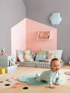 Adorable paint, floor cushions, soft pillows and the first infant toys in the nursery when baby starts moving about. Great idea...