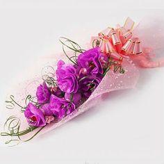 http://www.grzero.com.br/arranjo-de-flores-com-papel-decorado-com-crepom/