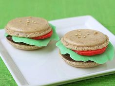 """Big Mac"""" Macarons A dessert burger? Sure, we'll give it a shot. Rachael of food blog La Fuji Mama has taken the delicate French macaron and given it a distinctly American feel with these """"Big Mac"""" Macarons. The buns are classic almond macarons, the patty is made of bittersweet chocolate ganache, and the lettuce and tomatoes are crafted out of a bizarre candy called chocolate plastic."""