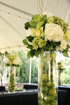 Wedding Flowers :Hydrangea, mini-hydrangea, roses, cymbidium orchids, kale, dahlia, hanging amaranthus, bells of ireland, galax, lemon leaves, curly willow.