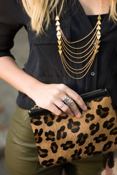 I particularly like the color combo the subtle tribal necklace with the leopard print. Edgy without being overboard.