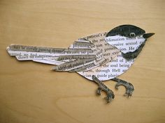 .Make a bird out of scraps of old book pages. Use inks or markers to colour in.