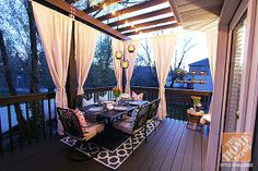 You won't believe what this gorgeous deck looked like before its makeover! Click through to see. || Deck Decorating Ideas: A Pergola, Lights and DIY Cement Planters, by Jen Stagg || @Jenn L Stagg