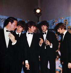 Brian Epstein (left), photographed alongside George Harrison, John Lennon, Paul McCartney and Ringo Starr. — AFP pic