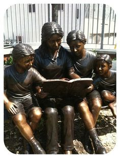 Reading a Book sculpture at the Southeast Anchor Library, 3601 Eastern Avenue, Baltimore, Maryland