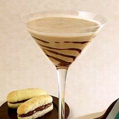 Tiramisu Martini - Makes 2 servings:  1/4 cup espresso; 4 oz Baileys Original Irish Cream; 1/3 cup sweet mascarpone cheese; 2 scoops vanilla, chocolate or coffee ice cream; 2 to 4 ice cubes.  Garnish:  2 soft ladyfinger cookies sliced lengthwise, 2 tbsp Nutella or Chocolate spread, Chocolate syrup.  DIRECTIONS:  Blend together the espresso, Irish Cream, ice cream, mascarpone, and ice until smooth. Turn on the Froth/Whip setting on the blender and whisk for 5 seconds. Drizzle chocolate syrup a...
