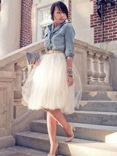 Love the white tutu skirt along with her jeans coat and a cute pair of Cinderella shoes. #fashion #girlish