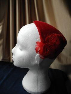 Red vintage velvet and feather hat by PinUpCarbootSale on Etsy, £10.00